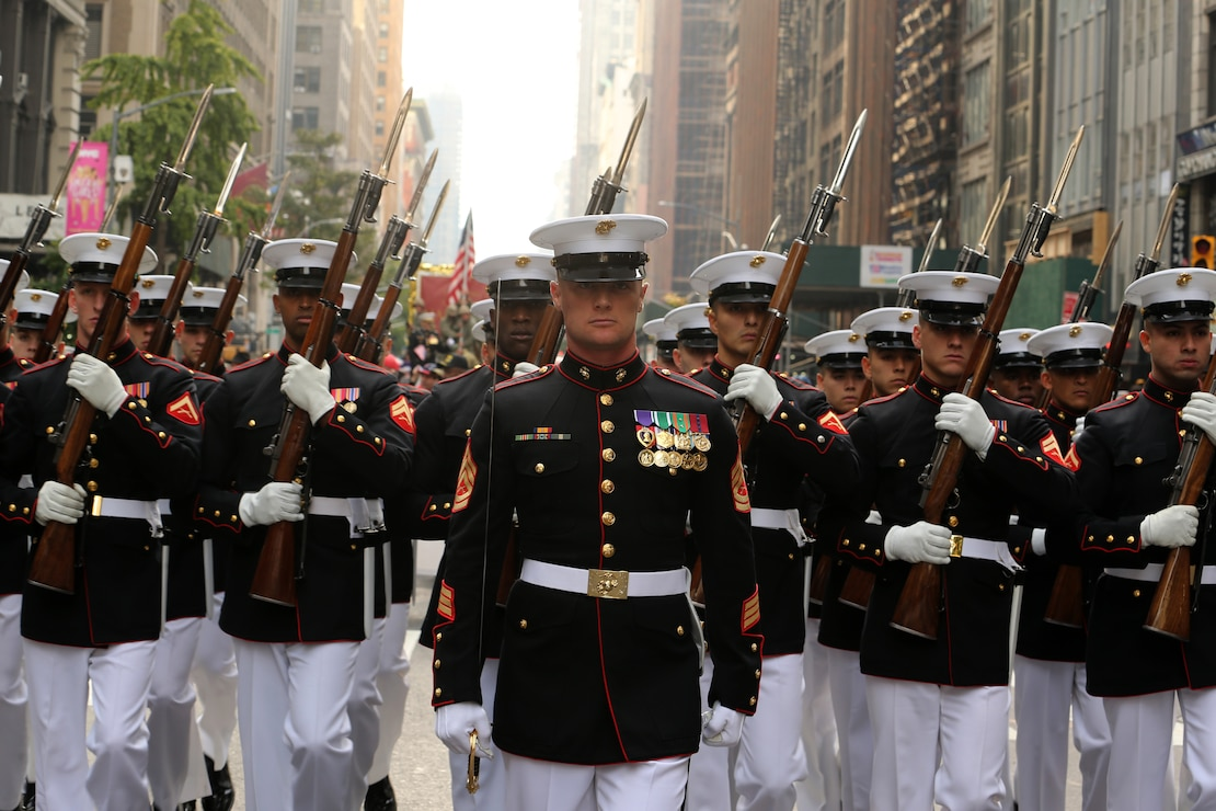 Marines with the U.S. Marine Corps Silent Drill Platoon march in formation during the 2019 Veteran's Day Parade in New York, New York, Nov. 11, 2019. The Veteran's Day Parade is hosted annually to commemorate the service and sacrifice of service members and their families.