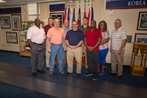 Civilian staff of 6th Marine Corps District pose for a group photo in observance of Veteran's Day at the 6MCD Headquarters aboard Marine Corps Recruit Depot Parris Island, South Carolina on Nov. 8, 2019. Each individual served in the military and contine to support the Marine Corps recruiting mission. (U.S. Marine Corps photo by Sgt. Jorge Rosales)