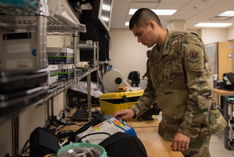 U.S. Air Force Airman 1st Class Timothy Torres, 633rd Medical Group biomedical equipment technician, prepares to repair a defibrillator at Joint Base Langley-Eustis, Virginia, Nov. 8, 2019. BMETs provide timely equipment repair to the hospital helping to ensure patient care. (U.S. Air Force photo by Airman 1st Class Sarah Dowe)