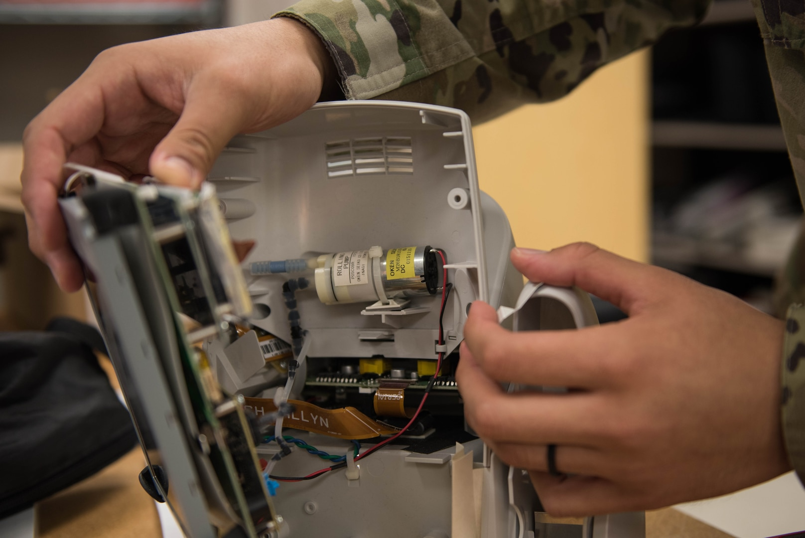 U.S. Air Force Airman 1st Class Timothy Torres, 633rd Medical Group biomedical equipment technician, checks on the motor of a vital signs monitor at Joint Base Langley-Eustis, Virginia, Nov. 8, 2019. BMETs are responsible for routine inspections of equipment throughout Langley Hospital. (U.S. Air Force photo by Airman 1st Class Sarah Dowe)
