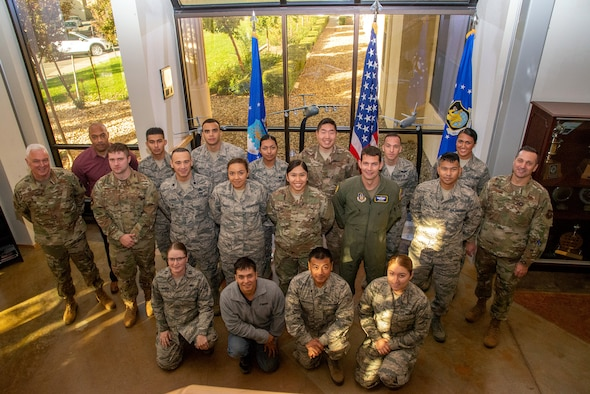 ol. Scott McLaughlin, 349th Air Mobility Wing commander, and Chief Master Sgt. James Burmeister, 349th AMW command chief, pose with the unit's  newest members during the November Unit Training Assembly Nov. 2, 2019, at Travis Air Force Base, Calif.
