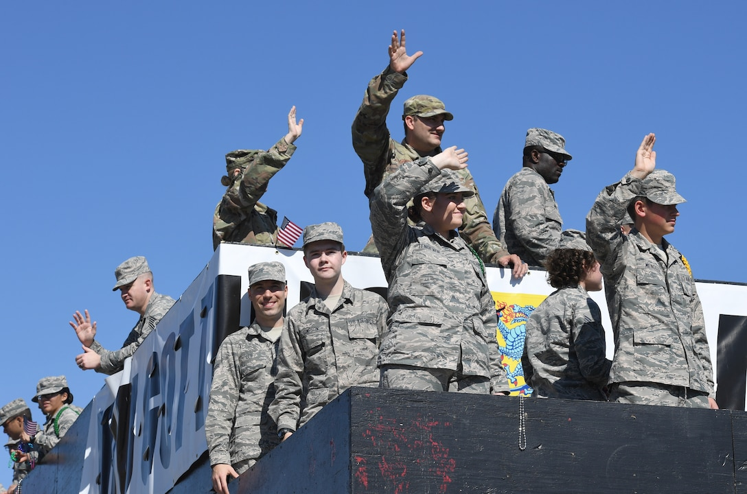 Airmen from the 81st Training Group ride in a float during the 19th Annual Gulf Coast Veterans Day Parade in DíIberville, Mississippi, Nov. 9, 2019. Keesler Air Force Base leadership, along with hundreds of Airmen, attended and participated in the parade in support of all veterans past and present. More than 70 unique floats, marching bands and military units marched in the largest Veterans Day parade on the Gulf Coast. (U.S. Air Force photo by Kemberly Groue)