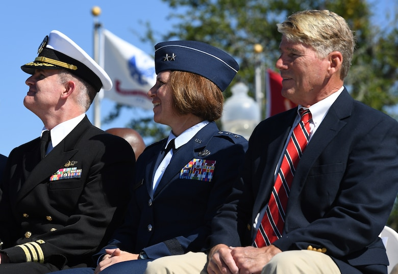 U.S. Air Force Maj. Gen. Andrea Tullos, Second Air Force commander, (center), sits in the reviewing stand with U.S. Navy Commander William Pitcairn IV, Naval Construction Battalion Center executive officer, Gulfport, Mississippi, and Gene Taylor, former U.S. Representative, during the 19th Annual Gulf Coast Veterans Day Parade in DíIberville, Mississippi, Nov. 9, 2019. Keesler Air Force Base leadership, along with hundreds of Airmen, attended and participated in the parade in support of all veterans past and present. More than 70 unique floats, marching bands and military units marched in the largest Veterans Day parade on the Gulf Coast. (U.S. Air Force photo by Kemberly Groue)