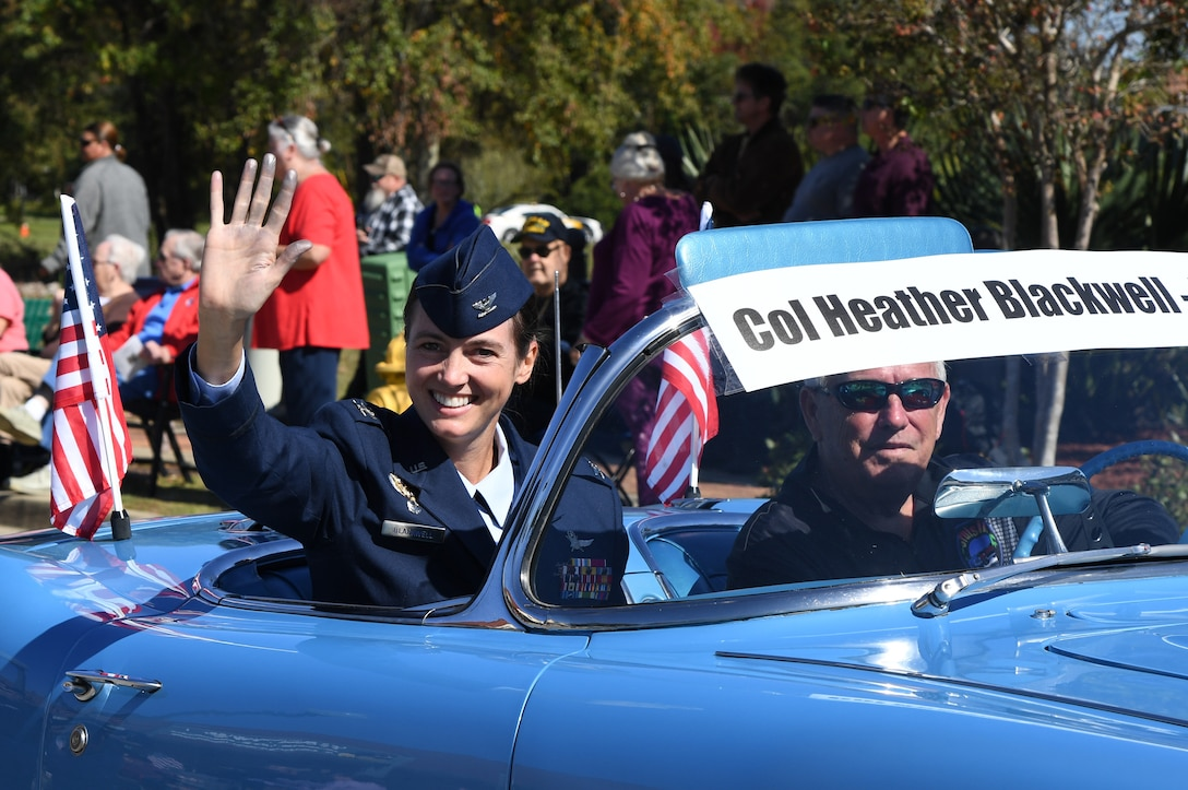 U.S. Air Force Col. Heather Blackwell, 81st Training Wing commander, waves to the crowd during the 19th Annual Gulf Coast Veterans Day Parade in DíIberville, Mississippi, Nov. 9, 2019. Keesler Air Force Base leadership, along with hundreds of Airmen, attended and participated in the largest Veterans Day parade on the Gulf Coast. (U.S. Air Force photo by Kemberly Groue)