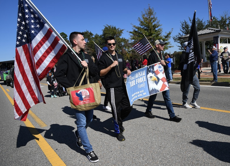 Air Force Sergeants Association members march in the 19th Annual Gulf Coast Veterans Day Parade in DíIberville, Mississippi, Nov. 9, 2019. Keesler Air Force Base leadership, along with hundreds of Airmen, attended and participated in the parade in support of all veterans past and present. More than 70 unique floats, marching bands and military units marched in the largest Veterans Day parade on the Gulf Coast. (U.S. Air Force photo by Kemberly Groue)