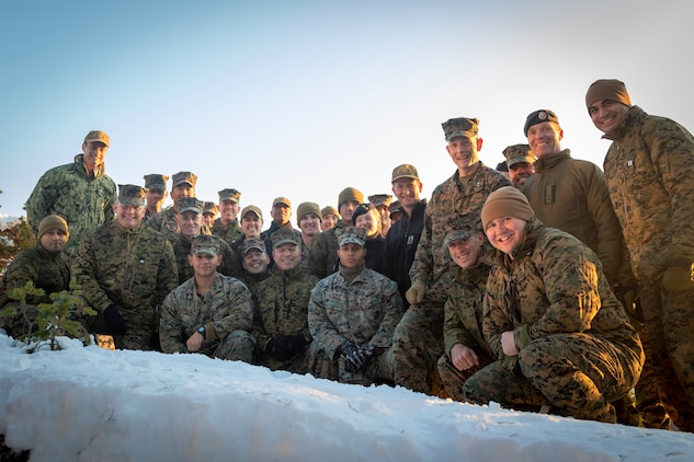 U.S. Marines, Sailors and Norwegian Armed Forces pose for a group photo during Trident Jupiter at Bodø, Norway, Nov. 5, 2019. Exercise Trident Jupiter brings together NATO nations to assess their ability to conduct high-end, NATO-level mission planning and execution in a simulated scenario against a peer adversary.  It also trains and evaluates the ability of STRIKFORNATO to command and control high-end joint warfare operations including the integration of U.S. naval, carrier, and amphibious forces into NATO operations. (Courtesy Photo)