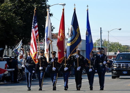The Joint Service Color Guard marches with the American Flag and the various military branch flags during the Veterans Day Parade in San Angelo, Texas, Nov. 9, 2019. Veterans Day is a day dedicated to the patriotism and duty of those who have served. (U.S. Air Force photo by Airman 1st Class Robyn Hunsinger/Released)