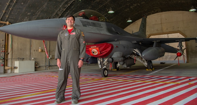 U.S. Air Force Capt. Kaleb Jenkins, 480th Expeditionary Fighter Squadron F-16 Fighting Falcon pilot and 52nd Fighter Wing Blue Flag project officer, Spangdahlem Air Base, Germany, poses for a photograph in front of an F-16C Fighting Falcon during Blue Flag 2019 at Uvda Air Base, Israel, November 7, 2019. Approximately 250 Airmen from Spangdahlem AB participated in Blue Flag alongside service members from other allied nations to build partnership capacity, strengthen capability and increase interoperability. (U.S. Air Force photo by Airman 1st Class Kyle Cope)