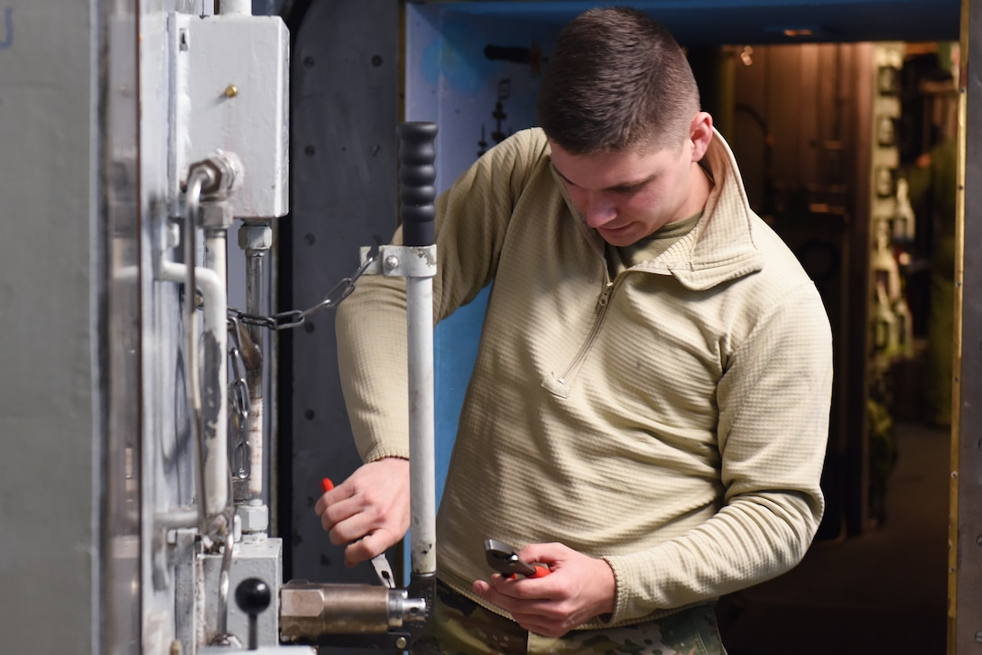 Airman 1st Class Zhane Paul, 341st Missile Maintenance Squadron survivable systems team member, performs maintenance on a launch control center blast door Oct. 29, 2019, at a Missile Alert Facility near Malmstrom Air Force Base, Mont.