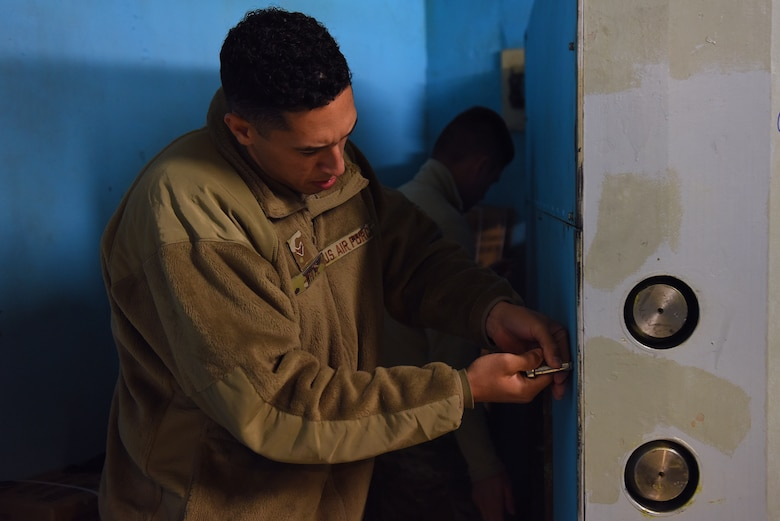 Airman 1st Class Anthony White, 341st Missile Maintenance Squadron survivable systems team member, performs maintenance on a launch control center blast door Oct. 29, 2019, at a Missile Alert Facility near Malmstrom Air Force Base, Mont.