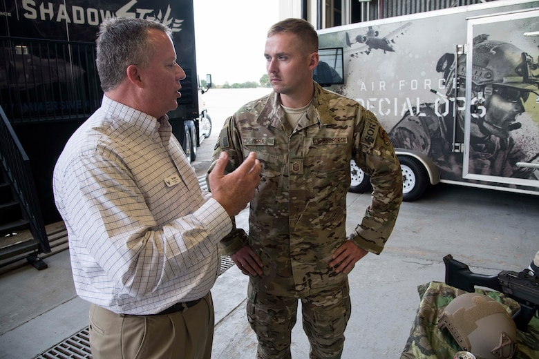Master Sgt. Anthony Merx, of the 330th Recruiting Squadron, talks to Tim Burke, an Air Force Civic Leader member, about gear that a Special Warfare operator would potentially use on a mission during the group's tour of Air Force Recruiting Service and Joint Base San Antonio-Randolph, Texas, on Nov. 6, 2019.