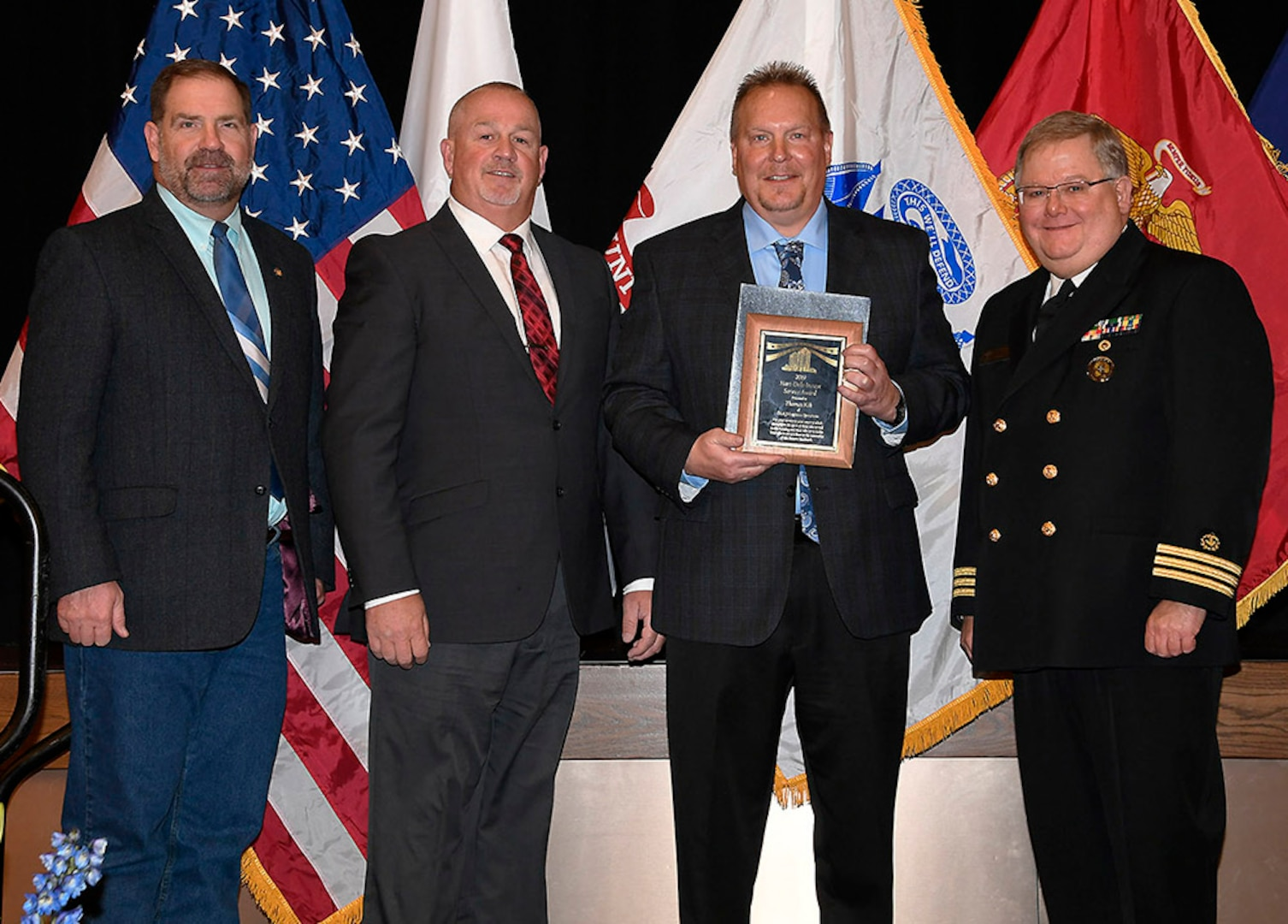 DLA Logistics Information Services' Thomas Kik (center) is awarded a 2019 Hart-Dole-Inouye Federal Center Service Award Nov. 8. Also pictured are DLA Disposition Services Director Mike Cannon, Logistics Information Services Training Branch Chief Mike Chapman and Battle Creek Military Affairs Committee Chairman T.R. Shaw, U.S. Navy, retired.