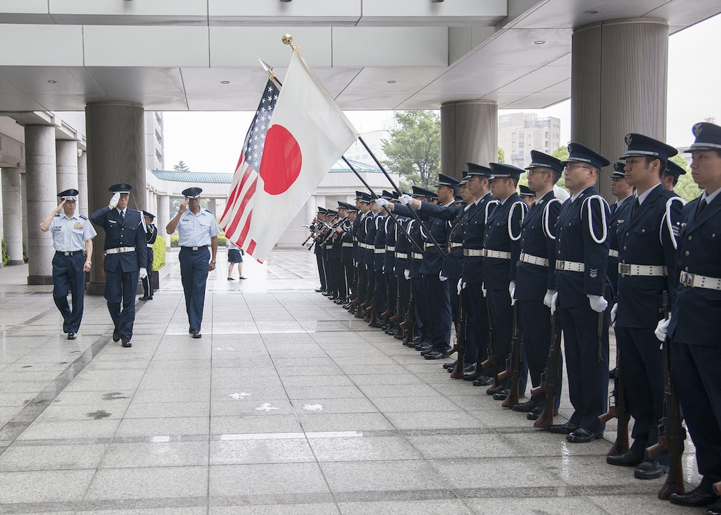 Gen C.Q. Brown, Jr., Pacific Air Forces commander, and Gen Yoshinari Marumo, chief of staff, Japan Air Self Defense Force, perform an inspection of the honor guard during a ceremony at the Ministry of Defense in Tokyo, Japan, 7 August 2018. Brown visited the country to affirm the United States' shared commitment to a free and open Indo-Pacific as well as to seek opportunities to enhance cooperation and coordination across the alliance.