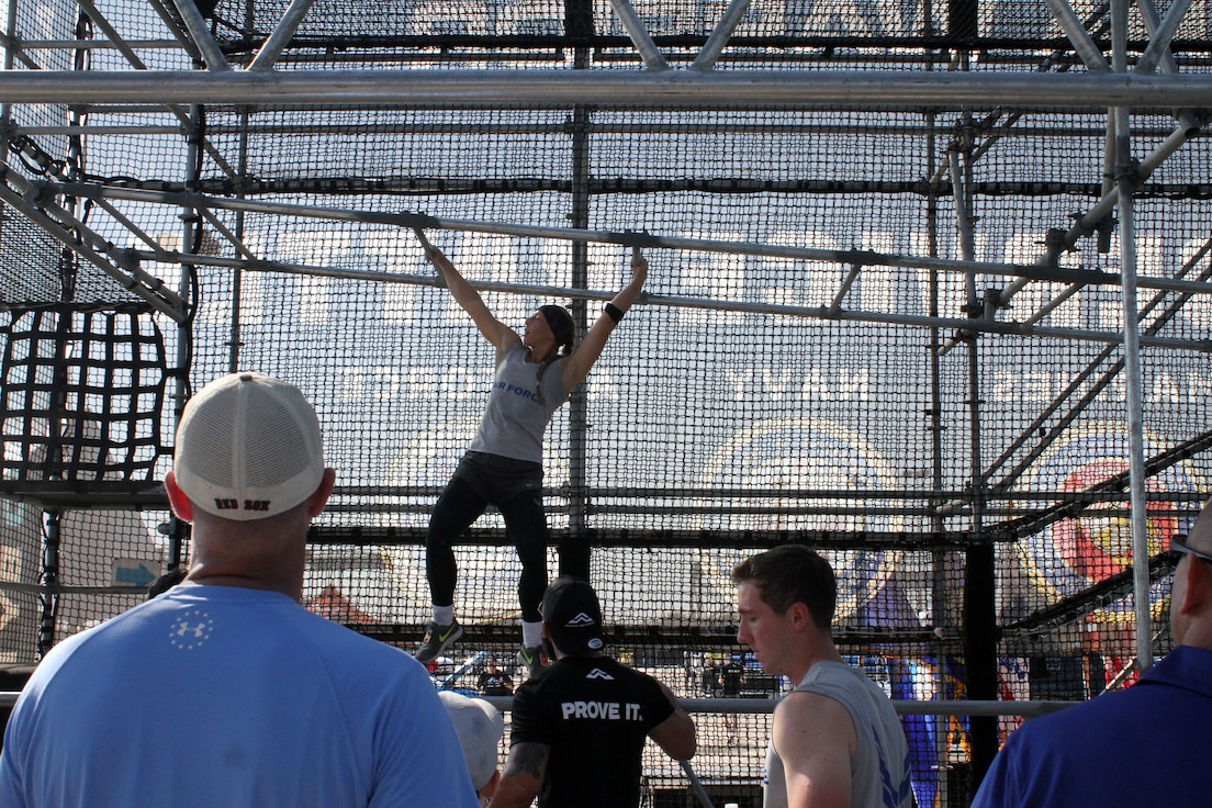 A crowd watches as Air Force 2nd Lt. Arielle Miller tackles the multi-leveled Alcatraz obstacle during the 2019 Alpha Warrior Inter-Service Battle at Retama Park, Selma, Texas, Sept. 14, 2019. In its second year, the battle brought together teams from the Air Force, Navy and Army to determine service champions. The Air Force won the first battle last year and successfully defended its crown, winning again in 2019. (U.S. Air Force photo by Debbie Aragon)