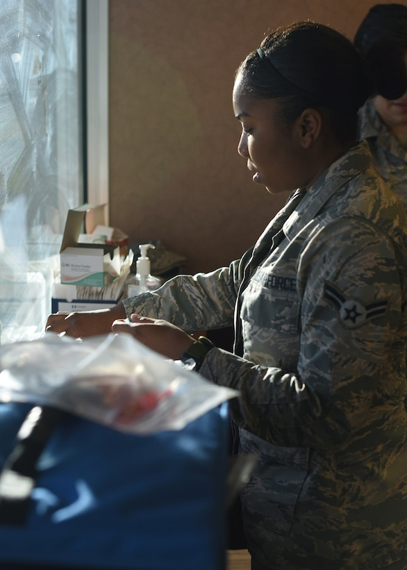 Airman 1st Class Tia N. Johnson, 460th Medical Group medical technician, prepares to administer flu shots during the flu drive at Buckley Air Force Base, Colo., Nov. 5, 2019.