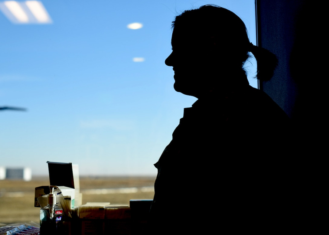 Staff Sgt. Sarah L. Atamian, 460th Medical Group medical technician, stands in front of a window during the flu drive on Buckley Air Force Base, Colo., Nov. 5, 2019.
