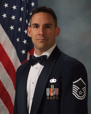 Official photo of MSgt. Jeffrey Valentine, steel guitarist with Wild Blue Country and trombonist with the Marching Band, two of nine ensembles in the United States Air Force Academy Band, Peterson Air Force Base, Colorado.
