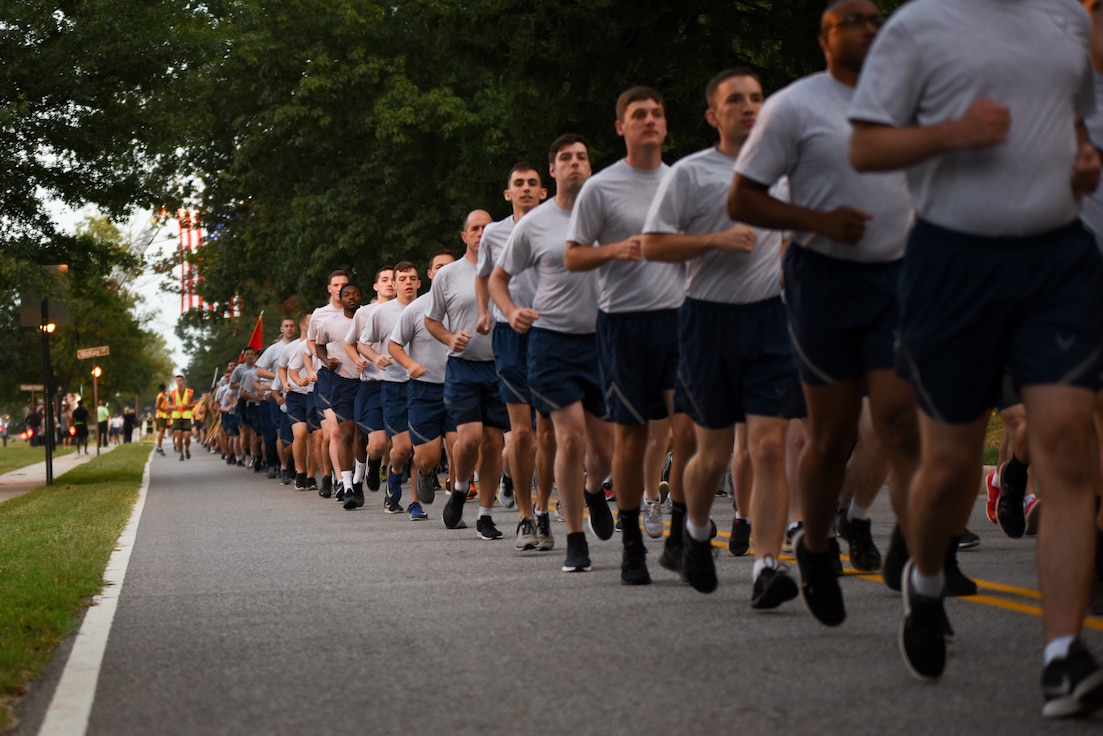 Members of the Fort George G. Meade community run in formation prior to a 9/11 Memorial ceremony Sept. 11, 2019, at Fort George G. Meade, Maryland. The installation came together for a resiliency run to remember and honor the lives lost during the Sept. 11, 2001, terrorist attacks. (U.S. Air Force photo by Airman 1st Class Madison Kaulukukui)