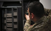 U.S. Air Force Staff Sgt. Slade Muraira, 437th Aircraft Maintenance Squadron Support shift leader, inspects a newly acquired auto-crib machine that was purchased for the squadron at Joint Base Charleston, S.C., Nov. 8, 2019. The new auto-mated tool crib will be able to hold the same amount of tools and maintenance parts and only take up half the space. The Airmen and NCOs of the support tool room went through a yearlong process of requesting and justifying the purchase of an automated tool crib to not only improve the quality of life for their Airmen in the shop, but also to increase their shop's positive impact on the Joint Base Charleston flightline. The tool crib will save over 1000 man hours in labor by automatically keeping accountability of any of the tools and parts that are checked out as well as assisting in keeping a constant inventory on items in stock. The machine will also notify members when new parts should be ordered based on the supply and demand tempo of each individual part.