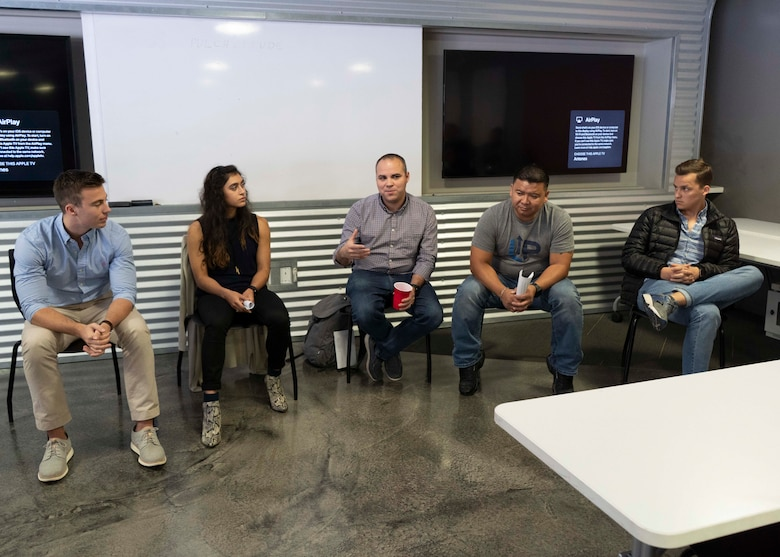 Members of the U.S. Air Force's solution center teams from LevelUP, KesselRun, Space CAMP, and Shadow OC sit on a panel during Project NEXUS' final mentorship event at the AFWERX Austin Hub, Texas, Oct. 16, 2019. Designed by the Air Education and Training Command Technology Integration Detachment, the beta test program was designed to fuel organic technology problem solving efforts for Airmen in their day-to-day workplaces with skills like software development, data science, and user interface/user experience design.(Air National Guard Photo by Staff Sgt. Jordyn Fetter)