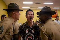 A new recruit with Fox Company, 2nd Recruit Training Battalion, responds to drill instructors during receiving at Marine Corps Recruit Depot San Diego, Nov. 4, 2019.