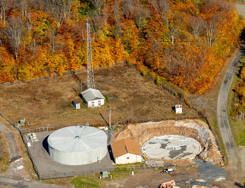 Photo of workers installing two 600,000-gallon tanks