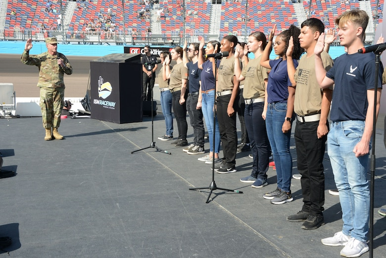 Gen. David L. Goldfein, Air Force chief of staff, conducts a total force enlistment prior to the NASCAR race Sunday in Phoenix
