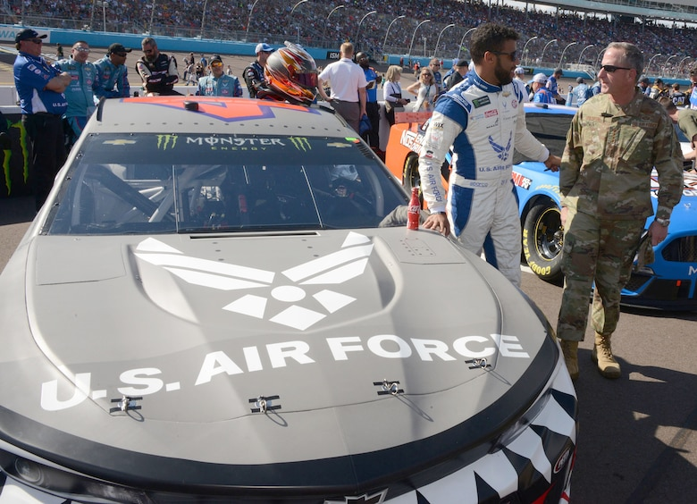 Bubba Wallace, the driver of the Air Force car, talks to Gen. David L. Goldfein, Air Force chief of staff, moments before the start of the Bluegreen Vacations 500 NASCAR race in Phoenix