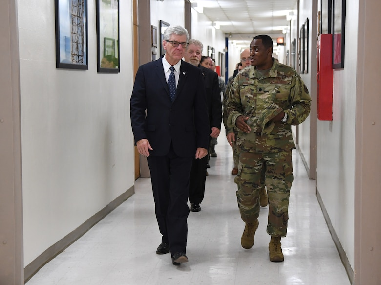 U.S. Air Force Lt. Col. Andre Johnson, 338th Training Squadron commander, escorts Phil Bryant, Governor of Mississippi, to a radio frequency transmission systems course graduation inside Jones Hall at Keesler Air Force Base, Mississippi, Nov. 8, 2019. Bryant presented certificates to the nine course graduates during the ceremony. (U.S. Air Force photo by Kemberly Groue)