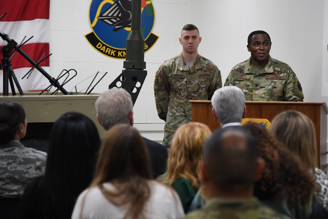 U.S. Air Force Lt. Col. Andre Johnson, 338th Training Squadron commander, delivers remarks during the radio frequency transmission systems course graduation inside Jones Hall at Keesler Air Force Base, Mississippi, Nov. 8, 2019. Phil Bryant, Governor of Mississippi, presented certificates to the nine course graduates during the ceremony. (U.S. Air Force photo by Kemberly Groue)