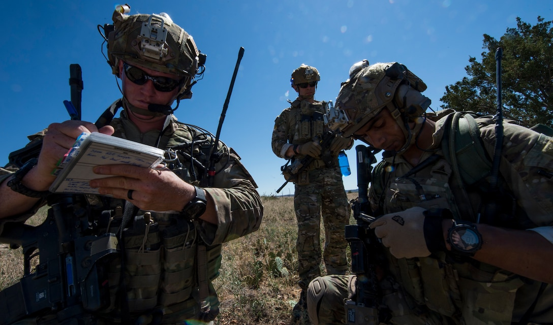U.S. Air Force Tactical Air Control Party (TACP) Airmen from the 13th Air Support Operations Squadron, communicate to a simulated pilot during a field training exercise near Fort Carson, Colo., July 15, 2019. The exercise tested the TACP Airmen on how to navigate through deployment-like terrain, perform reconnaissance and intelligence on an enemy and close-quarters weapons training. (U.S. Air Force photo by Staff Sgt. Matthew Lotz)