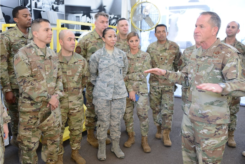 Gen. David. L. Goldfein, the Air Force chief of staff, talks to a group of total force recruiters during the Bluegreen Vacations 500 NASCAR race in Phoenix