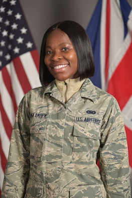U.S. Air Force Airman 1st Class Adwoa Anima Ampem, 100th Logistics Readiness Squadron supply equipment apprentice, poses for a picture at RAF Mildenhall, England, Nov. 5, 2019. As an Airman, Ampem is on her way to full citizenship as a new member of Team Mildenhall. (U.S. Air Force photo by Senior Airman Alexandria Lee)