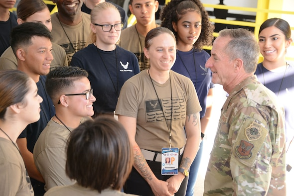 Gen. David. L. Goldfein, the Air Force chief of staff, talks to a group of 20 soon to be Airmen during the Bluegreen Vacations 500 NASCAR race in Phoenix