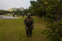 Marines with the 31st Marine Expeditionary Unit patrol to the objective during a no-notice flyaway Chemical, Biological, Radiological, Nuclear response exercise on Camp Hansen, Okinawa, Japan, Oct. 31, 2019.