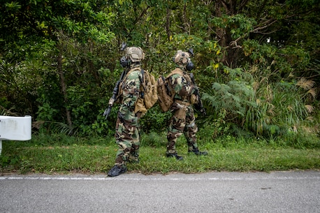 Marines with the 31st Marine Expeditionary Unit's Maritime Raid Force provide security during a no-notice flyaway Chemical, Biological, Radiological, Nuclear response exercise on Camp Hansen, Okinawa, Japan, Oct. 31, 2019.
