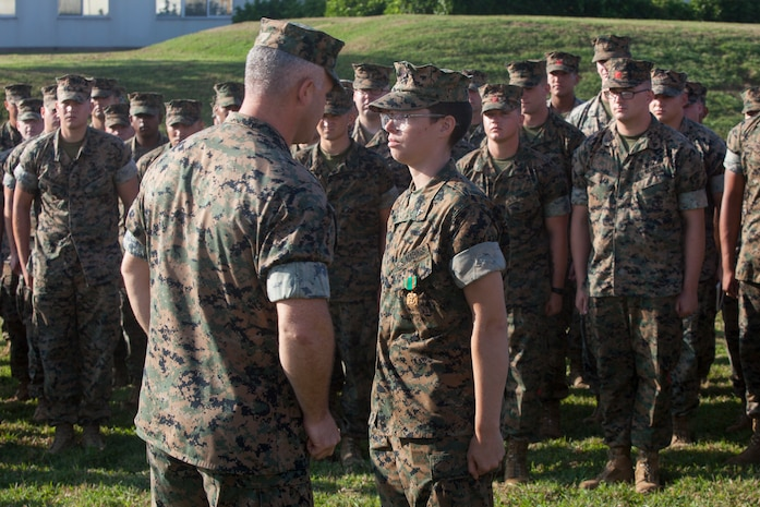 Lance Cpl. Ashley Breed, a satellite communications operator with Combat Logistics Battalion 31, 31st Marine Expeditionary Unit, receives the Navy and Marine Corps achievement medal at Camp Hansen, Okinawa, Japan, Oct. 4, 2019. The 31st MEU, the Marine Corps' only continuously forward-deployed MEU, provides a flexible and lethal force ready to perform a wide range of military operations as the premier crisis response force in the Indo-Pacific region.