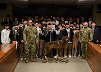 U.S. Air Force Col. Patrick Misnick, 8th Medical Group commander, and Chief Master Sgt. Steve Cenov, 8th Fighter Wing command chief, pose for a group picture with a group of students from Gunsan Dong High School during their visit at Kunsan Air Base, Republic of Korea, Nov. 8, 2019. The tour included meeting wing leadership, checking out an F-16 Fighting Falcon and observing an 8th Security Forces Squadron military working dog demonstration. (U.S. Air Force photo by Staff Sgt. Anthony Hetlage)
