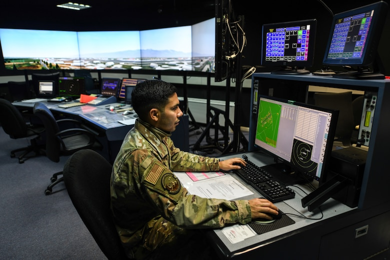 U.S. Air Force Staff Sgt. Daniel Cabezas, an air traffic control watch supervisor from the 31st Operations Support Squadron, pilots a tower simulator system at Aviano Air Base, Italy, Nov. 13, 2019. The TSS trains air traffic controllers for proficiency in upgrade training and helps our host nation with their certifications. (U.S. Air Force photo by Airman 1st Class Ericka A. Woolever).
