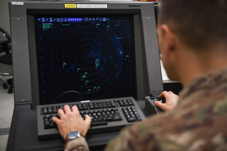 U.S. Air Force Senior Airmen Kyle Burns, a radar airfield weather systems technician from the 31st Operations Support Squadron, looks at processed data from the Digital Airport Surveillance Radar at Aviano Air Base, Italy, Nov. 13, 2019. The DASR provides real time location, altitude and range for all aircraft within a 60 mile radius. (U.S. Air Force photo by Airman 1st Class Ericka A. Woolever).