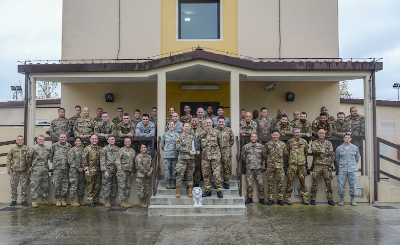 Members of the 31st Operations Support Squadron pose for a photo at Aviano Air Base, Italy, Nov. 8, 2019. The squadron won the 2018 USAF D. Ray Hardin Air Traffic Control Facility of the Year Award, which recognizes outstanding accomplishments from Air Traffic Control teams. (U.S. Air Force photo by Airman Thomas S. Keisler IV)