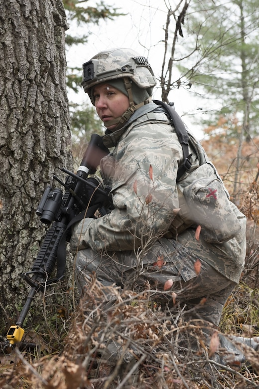 U.S. Air Force Master Sgt. Tammy Marks, assigned to the Security Forces Squadron at the 167th Airlift Wing, West Virginia Air National Guard, kneels in a wooded area during a combat training scenario in Alpena, Mich., Nov. 5, 2019. Approximately 300 members assigned to the 167th deployed to the Combat Readiness Training Center Nov. 3-7. (U.S. Air National Guard photo by Senior Master Sgt. Emily Beightol-Deyerle)