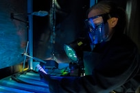 Amber Wedding, 437th Non Destructive Inspection test lead, checks a cracked chrome panel from a C-17 with a penetrant inspection system Nov. 1, 2019, at Joint Base Charleston, S.C. The penetrant inspection systems is designed for testing parts for defects or inconsistencies.