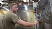 Senior Airman David Keys, 437th Maintenance Squadron, Fabrication Flight metals technology, turns on the computer numerical control machine Oct. 25, 2019, at Joint Base Charleston, S.C. The CNC drills, bores and lathes C-17 parts. The fabrication flight completes approximately 5,900 C-17 repairs annually.