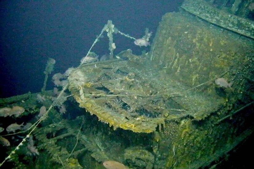The wreck of a sunken submarine sits underwater.