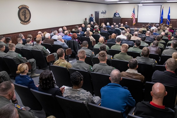"""U.S. Air Force Col. Mark Robinson, 12th Flying Training Wing commander, speaks during 558th Flying Training Squadron's Oliver """"Ollie"""" Crawford building dedication ceremony Nov. 13, 2019, at Joint Base San Antonio-Randolph, Texas. Crawford was a pilot, charter member of the Air Force Association and was instrumental in the formation of the Air Force Memorial in Washington, D.C. Crawford Hall is home to the 558th FTS, which is the sole source for all U.S. Air Force and U.S. Marine Corps undergraduate remotely piloted aircraft pilot and sensor operator training. (U.S. Air Force photo by Sean M. Worrell)"""
