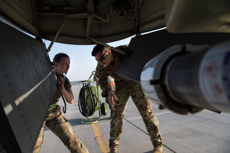 A 385th Expeditionary Aircraft Maintenance Squadron Airman and a 28th Expeditionary Air Refueling Squadron pilot perform pre-flight inspections on a KC-135 Stratotanker before an aerial refueling mission at Al Udeid Air Base, Qatar, Sept. 21, 2019.The 28th EARS, part of U.S. Air Forces Central Command, is responsible for delivering fuel to U.S. and coalition forces, enabling a constant presence in the area of responsibility. (U.S. Air Force photo by Master Sgt. Russ Scalf)
