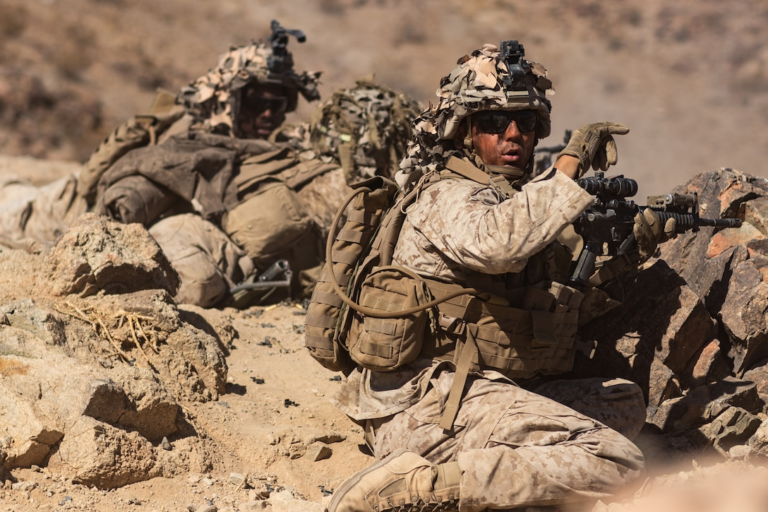 U.S. Marines with 1st Battalion, 6th Marine Regiment, 2nd Marine Division communicate using hand-arm signals during Integrated Training Exercise 1-20, at Marine Corps Air Ground Combat Center, Twentynine Palms, Calif., Oct. 9, 2019. The purpose of ITX 1-20 is to create a challenging, realistic training environment that produces combat-ready forces capable of operating as an integrated Marine Air Ground Task Force and to prepare units to participate in the MAGTF warfighting exercise scheduled to be held early November.