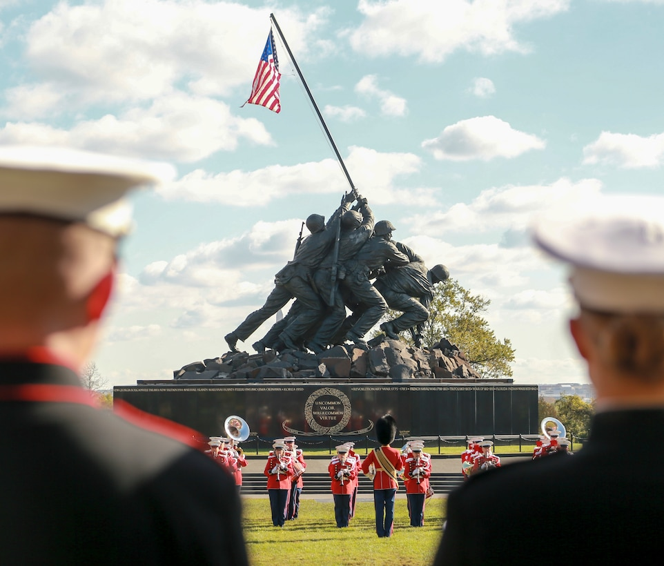 "Marines with ""The President's Own"" U.S. Marine Band perform during a Wreath Laying Ceremony at the Marine Corps War Memorial Arlington, Virginia, Nov. 8, 2019. Small teams of Marines also visited several gravesites of former commandants of the Marine Corps to render honors to these Marines. These ceremonies are held to celebrate these Marines' love and devotion to their Corps and Country, and to celebrate the Marine Corps birthday."