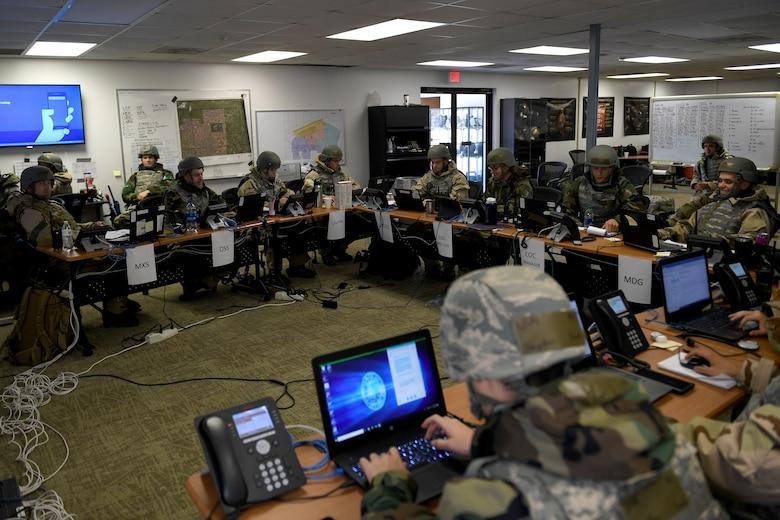 Airmen sits at a large desk